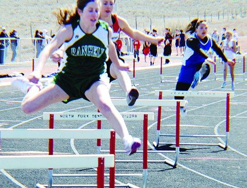 Photo by Amanda Aehehart. Freshman Aimee Hogan finished eighth in both the 100- and 300-meter hurdles.