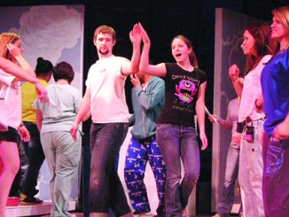 """Meeker junior Collin Cochran, who will play the characer """"Danny,"""" practices a dance with freshman Andrea Edinger. The MHS drama club and the International Thespian Society Troupe 1284, will perform the play Friday and Saturday at 7 p.m., both nights in the MHS auditorium. Photo by BECCA NIELSEN"""