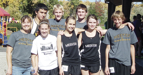 First-year coach Sheri Kehr stands with team members Krissie Harmon, Lindsey Patterson, Sydney Boes and Bailey Mantle. (Back row) Willis Begaye Jake Boesch and Lathrop Huges. Harmon, Boesch and Hughes all qualified for the state meet this Saturday in Denver.