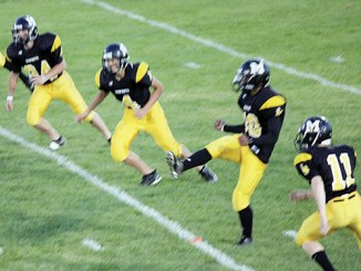 Meeker's Sebastian Clarke (24), Aaron Cochran (4), kicker Kevin Eli and Jake Phelan (11) and the rest of the Cowboys will kickoff in Paonia this Friday at 7 p.m. Photo by Dale Dunbar