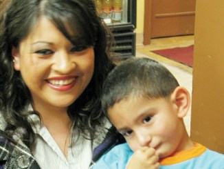 """A Horizons' """"success story,"""" Misael Rosas, 3, and his mother Susana are grateful for the services Misael received at Horizons in Meeker. Misael started preschool this fall after receiving speech and motor skills therapy through Horizons since infancy. This month Horizons is promoting the Little Points of Light fundraising campaign for its early intervention program, which provides free screenings for all children from birth to age 5 to identify developmental delays that can be addressed through therapy."""
