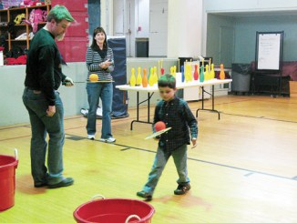 To celebrate library month at Meeker Elementary School, students recorded the minutes they spent reading in January. The top readers competed in Minute To Win It events with principal Jason Hightower. Elementary school student Cyros Halandras tested his balancing skills against Hightower's.
