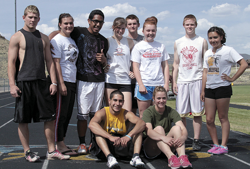 Meeker seniors Toby Casias and Kathryn Doll sit in front of teammates Sebastian Clarke, Bailey Atwood, Tala Atoafa, Aly Ridings, Lathrop and Sydney Huges, Jake Phelan and Linda Olivas, all qualified for the state meet starting today in Jefferson Stadium in Lakewood.