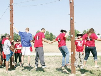 """Students get their first taste of activity on the CNCC Challenge Course as they worked on balance and how to """"spot"""" fellow students."""