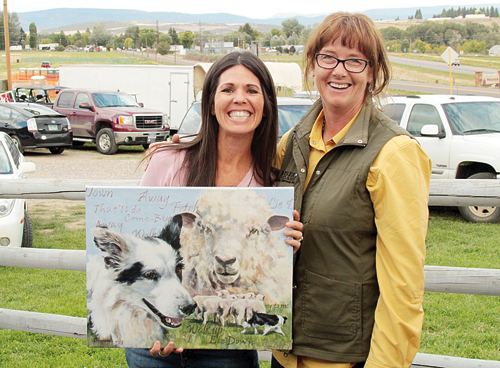 """Mary Francis Coryell and MCSCT director Maym Cunningham are pictured with the winning piece titled """"Taking Control"""" by Debbie Hughbanks of Loon Lake, Wash., who was unable to attend. Visit www.meekersheepdog.com/artwork.htm for more information."""