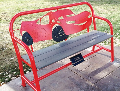 """Memorial benches and a walkway for Traker Dembowski were the outcome of Fruita artist Jeff Bates' work and efforts by a number of people in Rangely and Meeker. The benches represent Traker's favorite characters from the movie """"Cars."""""""