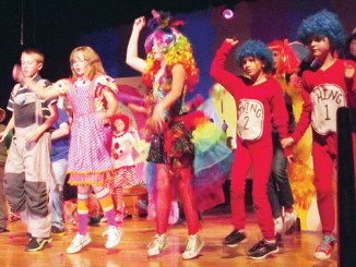 Cast members of the musical Seussical Jr. dance during a recent dress rehearsal before their upcoming performances Friday and Saturday. More than 50 young thespians have been rehearsing since August for Friday's performance at 6 p.m. And Saturday's performance at 3 p.m., both in the Meeker High School Auditorium.
