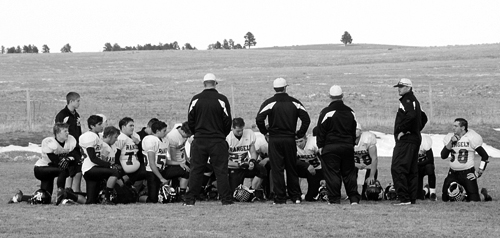 """Panthers take a knee after losing to the Kiowa Indians in the first round of the A-8 Colorado State Football Playoffs last Saturday. Second year head coach Paul Fortunato said his team """"left it all on the field"""" and the """"future looks bright"""" for the Rangely football program."""