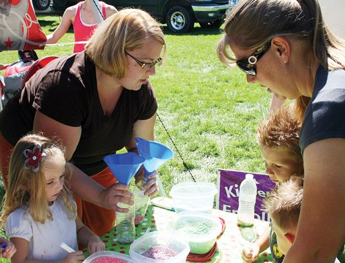 One of many ways Kindermusik instructor Brooke Lohse spread the word about the international children's music program coming to Rangely at a Septemberfest booth, where children created their own musical instruments to take home.