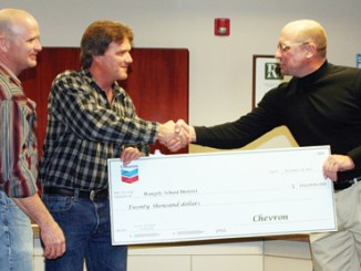 (From left) During Rangely School District's Board of Education meeting last week, Chevron plant operations supervisor Kelly Brown and operations supervisor Luke Allred presented a $20,000 check to Rangely Junior-Senior High School principal Berry Swenson to help fund an upper-level math and science position. The company is partnering with the board's STEM (Science, Math, Engineering and Technology) Consortium, whose goal is to help the top one-third of students in the district excel.