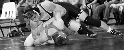 Cowboy freshman Devon Pontine uses a bar arm to turn his Glenwood Springs opponent last Saturday. Pontine pinned all four of his opponents and will enter this weekend's regional state-qualifying tournament as the No. 3 seeded wrestler in the 152-pound bracket.