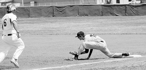 Rangely junior Cameron Enterline stretches to make an out at first base against the Bulldogs in Hotchkiss last Saturday. Enterline and the Panthers will be in Meeker this Saturday (11 a.m.) for Meeker's first home game and the second doubleheader the two Rio Blanco County teams have played against each other this season.