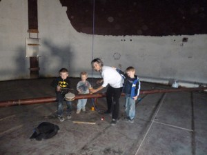 Children's music recording artist Lois LaFond spent time making music in the tank last week with several Rangely children (from left: Drew Zadra, Zane Wiley and Caleb Wiley). The Friends of the Tank successfully raised more than $46,000 in three weeks to secure and restore the unused water tank for the next generation of sound-makers.