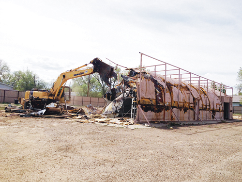 Last week's demolition of what was popularly known as the Peacock Building on South Stanolind Avenue, where Peacock Oil Co. and several other businesses operated over the last six decades, marked the end of one era and the beginning of a new era in history. Owner Bud Striegel hopes to have an 80-by-180-foot steel building he plans to turn into a car museum on the site by August.