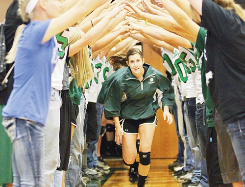 """Rangely senior Aimee Hogan runs out of the tunnel and onto the court where she """"assisted"""" her team in a big homecoming win over West Grand."""