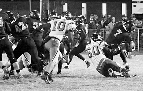 Panther senior Wesley Goddard (60) recorded 11 tackles including this one behind the line of scrimmage for a sack.