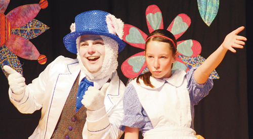 Rangely Junior High School seventh-grader Raelynn Norman as Alice, and the White Rabbit, portrayed by Missoula Children's Theater actor/director Ethan Park, consider the nonsense of others not knowing who you are and not always being sure yourself.