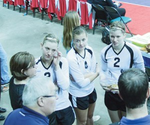 Meeker head coach Christy Atwood and her senior captains Taylor Nielson, Piper Haney and Aly Ridings listen to court instructions before playing Resurrection Christian, a private school in Loveland.