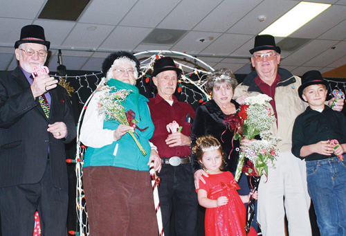 Christmasfest royalty was chosen over the weekend during holiday-related events in Rangely. Members of royalty, from left, are second attendant Norm Hall, first attendants Bettie Jo Hackford and Bill Dyer, crown bearer Brielle Lucero, Queen Phyllis Zadra, King Bill Zadra and crown bearer Wyatt Wiley.