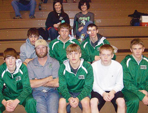 The Rangely Panthers wrestling team competed in Utah and eastern Colorado before the Christmas break to wrestle unfamiliar opponents and hope to take its success into 2014. Pictured at the 51st annual Bob Smith Invitational in Wray are, in front, Heath Peters, volunteer assistant coach Shad Peters, Lucas Heinle, Ryan Barlow and Ethan Allred. In back, Nych DeLeon, Ryan Wilczek and Caleb Lawson. The Panthers finished fourth as a team.