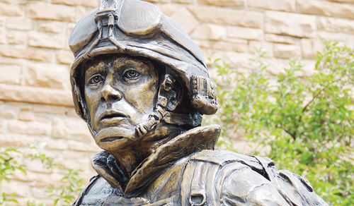 """A larger-than-life sculpture by Meeker sculptor John Kobald was dedicated July 4 in Meeker as the Rio Blanco County Veterans Memorial with the name of """"Sacrifice and Resolution."""" The statue is on the lawn in front of the county courthouse with a duplicate slated for Rangely in 2014."""