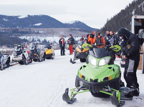 About 135 snowmobile riders get ready for the poker run to begin.