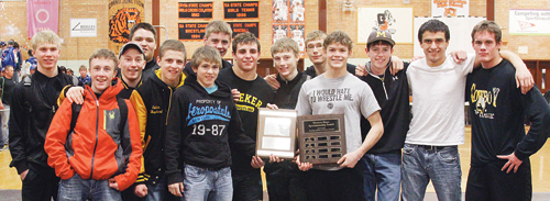 """The Meeker wrestling team was awarded the """"sportsmanship"""" plaque by northwest Colorado referees before the championship matches of the Region 1 state-qualifying tournament and several wrestlers posed with the award and second place plaque including: Casey Turner, Tristin Pelloni, Kylloe Goedert, Tyler Ilgen, Calvin Shepherd, Sheridan Harvey, Jake Henderson, TJ Shelton, Aaron Cochran, Anthony Watt, JC Henderson, Nick Burri, Willis Begaye and Chase Rule. The Cowboys qualified 10 wrestlers for the """"Big Show,"""" which starts today at 3 p.m. and can be followed online at trackwrestling.com."""