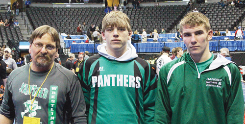 """Rangely head wrestling coach Jeff Heinle coached his son, Lucas, a senior, and Panther junior Ethan Allred in the 2014 Colorado State Wrestling Championships. Lucas Heinle qualified for the state meet all four years of his high school career and qualified as a regional champion this year. Allred qualified for the """"Big Show"""" for a second time, finishing one match away from the medal round. He will return to the team next year."""