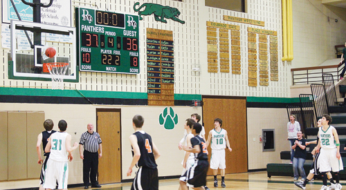 """""""It was too close for comfort,"""" Rangely boys' basketball coach Eric Hejl said of the district tournament pig-tail game against Hayden, which the Panthers won for the first time in three years, to advance to the district tournament in Oak Creek as the No. 3 seed. The team will play Paonia at 7:30 p.m. on Friday. Panthers Colt Allred (31), Kaulan Brady, Cameron Enterline, Connor Phelan (10) and Andrew Morton (22) could only watch as Hayden's last shot, with no time on the clock, bounced off the rim and gave the Panthers a one-point victory."""