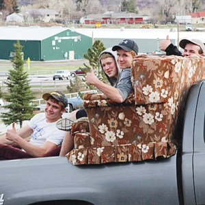 Meeker High School students Devon Pontine, Robby Jensen, Brady Bland and John Mac Sheridan watched the game from the comfort of a recliner and a couch in the back of a truck and may watch again tonight as the Cowboys host Grand Valley.