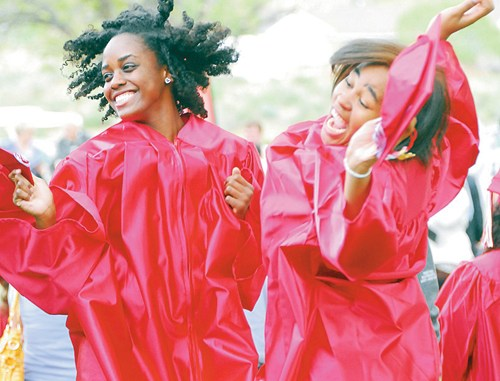 Showing their happiness that they received their associate's degrees at Colorado Northwestern Community College on Saturday, Attirah Munir, left, and Emoney Brown do their jump for joy.