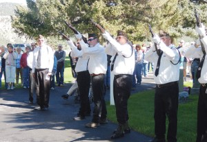 """Dave Cole, left, gives the order to """"Fire"""" for the 21-gun salute Monday morning as part of the Meeker Memorial Day observance at Highland Cemetery."""