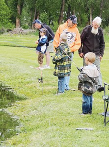 Several area children took advantage of Meeker Kids' Fishing Day on Saturday at Circle Park. Sponsored by the Colorado Department of Parks and Wildlife and the Meeker Lions Club, roughly a hundred kids, older siblings and parents took part in the event, which featured the young kids learning to fish and the Lions serving free lunch to the group.
