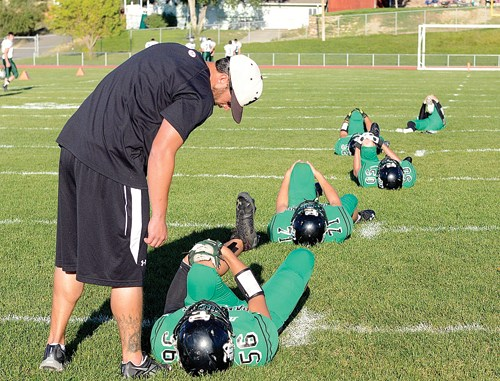 Rangely High School football coach Paul Fortunato encourages his players before last Friday's home game against Plateau Valley. The Panthers won to remain undefeated.