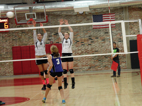 """Meeker High School seniors Paige Jones and Reagan Pearce reach above the net to defend a high shot against Moffat County during a match in Aspen. The Lady Cowboys opened the season with four matches, winning three and losing one. """"It was a good learning experience, but we have a lot to work on,"""" said first-year head coach Janae Stanworth. Meeker will play Vail Christian in Vail on Friday."""