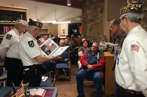 """Veterans of Foreign Wars Colorado District Commander Mark Wick and State Surgeon Ed Aitken recently presented Rangely VFW Post No. 5261 Commander John """"Hoot"""" Gibson and former commander Corky Powell Sr. with a certificate commemorating the post's 50th year in existence."""