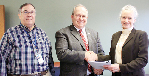 From left to right: BLM Colorado Paleontologist Harley Armstrong, Colorado Northwestern Community College President Russell George and BLM Colorado State Director Ruth Welch finalize a memorandum of understanding, creating a federal fossil repository at CNCC's Craig campus.