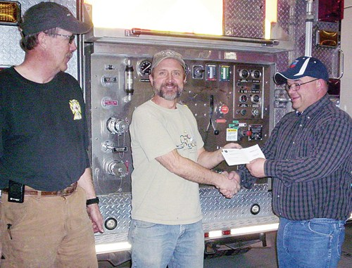 Wade Bradfield, chairman of the board, and Steve Allen, fire chief of the Rio Blanco Fire Protection District, would like to thank Chevron for its $4,000 donation to go toward gas monitors. The check was presented by Chris Archuleta.