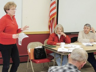 Roughly 60 members of the Rio Blanco County Woolgrowers Assocation gathered for their annual meeting on Friday in Meeker, and a wide variety of speakers addressed topics such as sheep protection dogs, sage grouse, water, the number of grazing units, declining wool prices and wild horses. The group met at Kilowatt Korner as speakers from mostly federal agencies presented updates on several issues relevant to raising sheep in the area and how the various agencies will be dealing with sheep producers in the near future. One of the first to speak was Callie Hendrickson, above, the executive director of the White River and Douglas Creek conservation districts. At the table are Woolgrowers' Secretary/Treasurer Connie Theos and Woolgrowers' President Butch Theos.