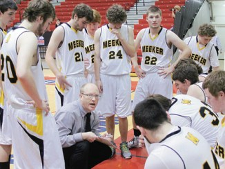 Meeker head basketball coach Klark Kindler, pictured above during a timeout, will graduate eight seniors from his team but he will have a good nucleus to build from, including juniors Ty Dunham and Jake Smith, along with freshmen Doak Mantle and Logan Hughes, all with varsity and now state experience.