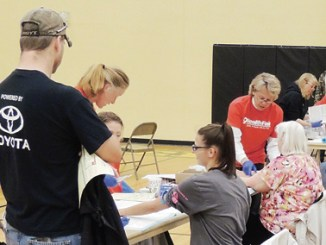 """Volunteers were helping en masse at the 9Health Fair at Meeker Elementary School on Saturday. Above, phlebotomists from all neighboring towns were on hand as were students from the CNCC dental hygiene school and health agencies from throughout the area joined efforts to deal with the roughly 600 people who attended the health fair on Saturday. The fair was sponsored by Channel 9, Pioneers Medical Center, the Rio Blanco Fire Protection District and the Meeker Lions Club. Organizer Christy Atwood of Pioneers Medical Center said, """"It was another successful year. I appreciate working with Channel 9 and appreciate all the members of the community taking part."""""""