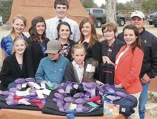Members of the Rio Blanco County 4-H Livestock Judging Team are pictured here with all of their awards following the Four Corners Ag Expo at the exhibition grounds in Cortez on March 16. Pictured in back row is Ty Dunham; middle row, from left to right, are: Jilly Bumguardner, Kacie Lapp, Madi Shults, Macy Collins and Marryn Shults; front row, from left to right, are: rookies Tatumn Kennedy, Hayden Shults and Eva Scritchfield. Not pictured are Abbi and Will Schwartz.