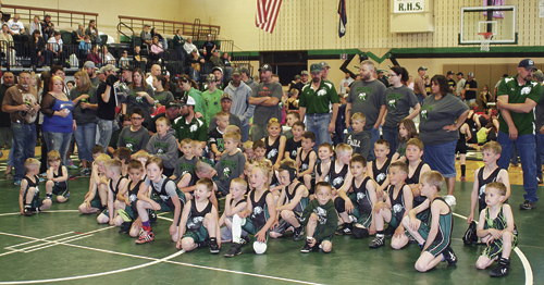 """Rangely youth wrestlers take a """"champion's stance"""" during Saturday's dedication of the Rangely Youth Wrestling Tournament as the Bill Turner and Family Legacy Day."""