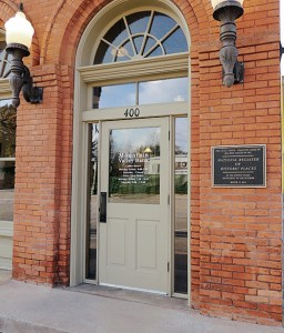 The front door of Mountain Valley Bank and a plaque denoting that the building is listed on the National Register of Historic Places.