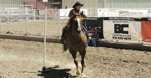 Jace Vroman takes his horse around the circuit of poles during the Rio Blanco County Fair in the 4-H Horsemanship Class on Saturday at the county fairgrounds. There were several contestants from around Rio Blanco County in the competition.