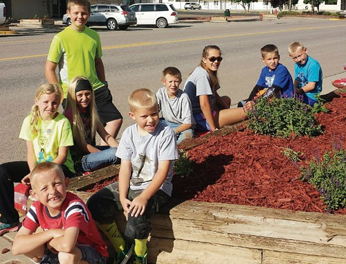 Ten members of the Rangely 4-H Club volunteered to complete one of the town's latest beautification projects the morning of July 8. The members planted more than 60 perennials in seven flowerbeds on both sides of Main Street between  True Value's garden center, Main Street Café and Raven Realty. Those members pictured, from front to back, are: Hudson Torsell, Easton Torsell, Ryan Mergelman, Kastyn Dembowski, Philip Noyes, Justin Allred, Klaire Denny, Josh Dunn and Jaxon Torsell.