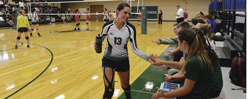 Sarah Conner slaps hands after coming off the court during the Lady Panthers three-set victory last Friday against Hotchkiss.