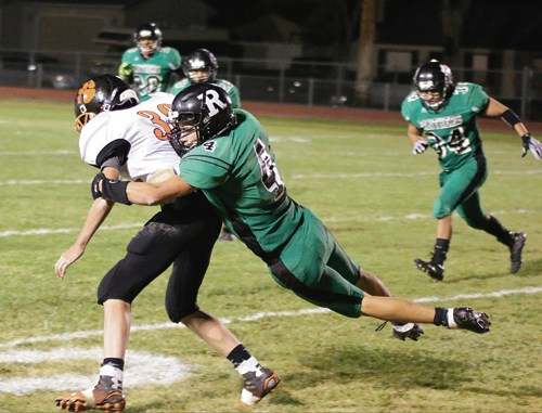 Junior Troy Allred takes down the Hayden ball carrier in Rangely's victory over Hayden.