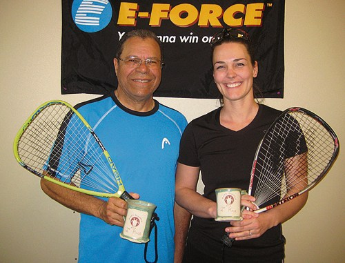 """Bob Sanders, left, of Payton, Colo., and Rangely resident Andrea Gianinetti, right, get a """"mug shot"""" taken of the second-place trophies they won in the C/D doubles division of the 23rd Rangely Racquetball Tournament, held March 4-6. One-third of this year's 29 tournament participants were local, and several of them were mothers brought into the sport by Gianinetti, who began learning from resident expert Shirley Parsons three years ago."""