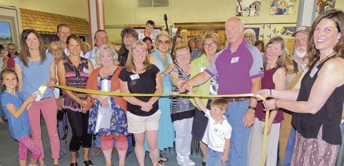 The Meeker Chamber of Commerce held a grand opening and ribbon cutting for the new Smoking River Studio Arts business at 627 Main St. in downtown Meeker. It is a juried, member-owned and operated artisan cooperative that operates as a gallery and studio. The business was the brain child of Jill and Dale Dunbar with the help of several other residents. Present for the ribbon cutting were, from left to right: Allison Kobald, chamber executive director Stephanie Kobald, artist Tony Francis, artist Steve Gamba, artist Cindy Rholl, artist Ted Relihan, artist Stephanie Gamba, photographer Dale Hallebach, artist Kathy Mayburry, artist Jaclyn Hafkenshiel, Cindy Welle, Jill Dunbar, young Jackson Dunbar, Dale Dunbar, artist Pat Sheeran-Daggett, Jere Taylor and chamber president Diana Jones.